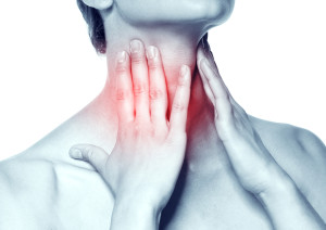 Acute pain in a throat at the young women. young girl keeps for a sick throat on a white background